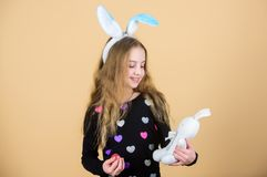 Easter activities for children. Holiday bunny little girl with long bunny ears. Child cute bunny costume. Kid hold. Tender soft rabbit toy. Easter day coming stock images