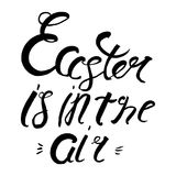 Easter is in the air lettering. Badge and Card for celebration. Stock Image