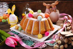 Easter almond ring cake on wooden table Royalty Free Stock Images