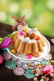Easter almond ring cake on wooden table Stock Image