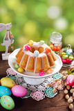 Easter almond ring cake on wooden table Stock Images