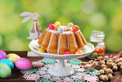 Easter almond ring cake on wooden table stock photo