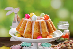 Easter almond ring cake on wooden table Stock Photos