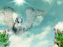 Easter angel. A statue of angel over spring Easter background with copy space Stock Image