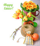 Easter arrangement with tulips, primrose and caption Stock Photography