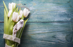 Easter arrangement  of a white tulips and wooden bird Stock Photo
