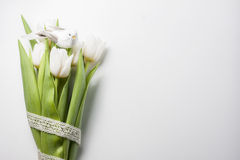 Easter arrangement  of a white tulips and wooden bird Royalty Free Stock Images