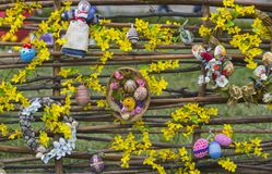 Easter art, decoration, floristry, design. Easter eggs and spring blossom on wicker fence. Happy easter concept. Spring holidays celebration royalty free stock images
