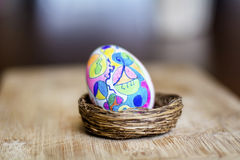 Easter artistic egg in nest  painted by hand. Vivid design easter Egg - hand  painted Royalty Free Stock Photo