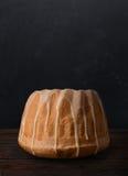 Easter babka cake on wooden planks. Stock Image