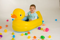 Easter baby 2. Cute baby girl in a big rubber ducky royalty free stock photos