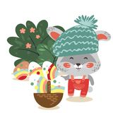 Easter baby bunny in hat and overalls holding big basket full of decorated egg, isolated whire rabbit with ears hunting Royalty Free Stock Photos