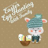 Easter baby bunny in hat and overalls holding big basket full of decorated egg, isolated whire rabbit with ears hunting Royalty Free Stock Image