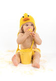 Easter Baby in Duck Costume. Baby girl wearing duck or chicken hat and diaper cover, studio isolated royalty free stock photo
