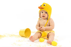 Easter Baby in Duck Costume. Baby girl wearing duck or chicken hat and diaper cover, studio isolated royalty free stock images