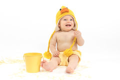 Easter Baby in Duck Costume. Baby girl wearing duck or chicken hat and diaper cover, studio isolated stock photography