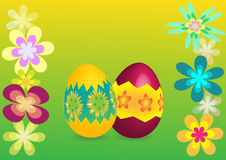 Easter background. Easter eggs on the green background with flowers Stock Photo
