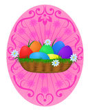 Easter background. Easter Eggs rainbow color in wicker basket with camomiles on festive rosy background Royalty Free Stock Photography