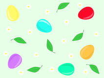 Easter background. Colored Easter eggs, leaves and flowers on green background Royalty Free Stock Images