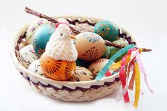 Easter background. Typical decoration for czech easter: decorated eggs with wap and chicken Royalty Free Stock Photo
