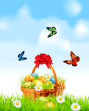 Easter background with a basket full Easter eggs Royalty Free Stock Image