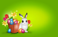 Easter background with basket with pile of easter eggs and bunny Royalty Free Stock Image