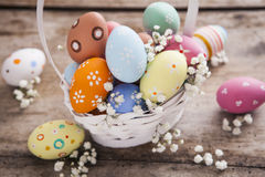 Easter background. Beautiful colorful eggs with spring flowers Royalty Free Stock Photo