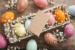 Easter background. Beautiful colorful eggs with spring flowers Stock Images
