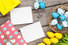Easter background with blank photo frames, blue and white eggs, Royalty Free Stock Images