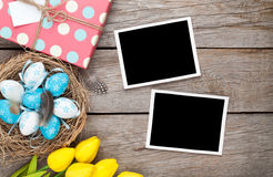 Easter background with blank photo frames, blue and white eggs, Stock Images