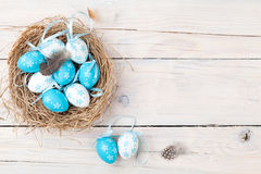Easter background with blue and white eggs in nest Stock Photo