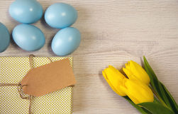 Easter background with blue and white eggs and yellow Stock Images