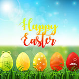 Easter background with bright easter eggs in the grass on sunny sky background Stock Images