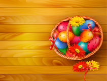 Easter background with color easter eggs in basket Stock Photo
