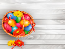 Easter background with color easter eggs in basket Stock Images