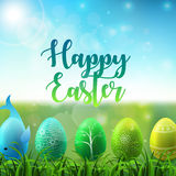 Easter background with colorful easter eggs in the grass on sunny sky background Royalty Free Stock Photos