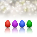 Easter background with colorful eggs and bokeh Stock Photos