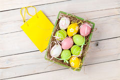 Easter background with colorful eggs and gift bag Stock Photo