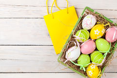 Easter background with colorful eggs and gift bag Royalty Free Stock Photos