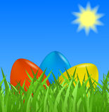 Easter background with colorful eggs. In grass Royalty Free Stock Photos