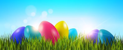 Easter Background With Colorful Eggs In Green Grass Over Blue Sky Horizontal Banner. Vector Illustration Stock Photography