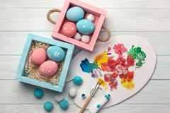 Easter background with colorful eggs, paints, brushes on stone gray royalty free stock photography