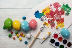 Easter background with colorful eggs, paints, brushes on stone gray. Top view with copy space.  stock images