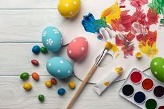 Easter background with colorful eggs, paints, brushes on stone gray. Top view with copy space.  royalty free stock images