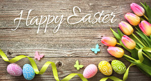Easter background with colorful eggs and spring tulips Royalty Free Stock Photography