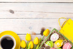 Easter background with colorful eggs and yellow tulips Stock Photography