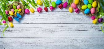 Easter background. Colorful spring tulips with butterflies and p Royalty Free Stock Photography