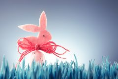 Easter background concept with pink bunny figure Royalty Free Stock Image
