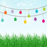 Easter background with copyspace in the sky featuring a cute Easter Bunny and lots of painted Easter Eggs Royalty Free Stock Image