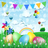 Easter background with countryside and Easter eggs Stock Photography